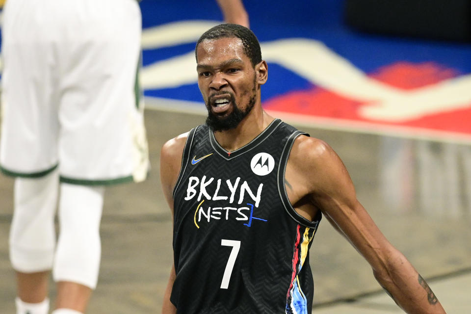 NEW YORK, NEW YORK - JUNE 07:  Kevin Durant #7 of the Brooklyn Nets celebrates a basket against the Milwaukee Bucks in Game Two of the Second Round of the 2021 NBA Playoffs at Barclays Center on June 07, 2021 in New York City. NOTE TO USER: User expressly acknowledges and agrees that, by downloading and or using this photograph, User is consenting to the terms and conditions of the Getty Images License Agreement. (Photo by Steven Ryan/Getty Images)