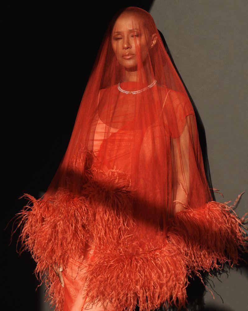 Photo credit: Iman wears Maison Margiela veil and dress with a Piaget necklace, photographed by Paola Kudacki