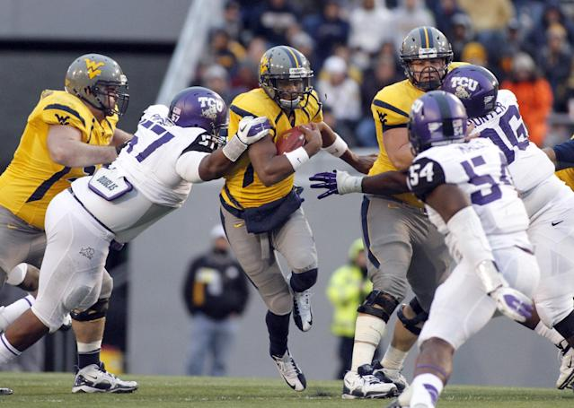 MORGANTOWN, WV - NOVEMBER 03: Andrew Buie #13 of the West Virginia Mountaineers carries the ball against the TCU Horned Frogs during the game on November 3, 2012 at Mountaineer Field in Morgantown, West Virginia. TCU defeated WVU in two overtimes 39-38. (Photo by Justin K. Aller/Getty Images)