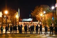 Washington police officers stand guard near the White House following the protest against election results in Washington