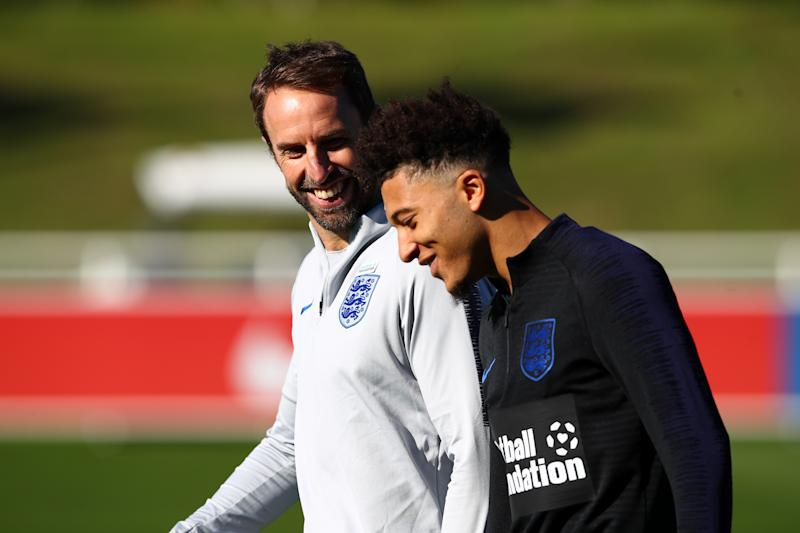BURTON-UPON-TRENT, ENGLAND - OCTOBER 09: Gareth Southgate speaks to Jadon Sancho during an England Training Session at St Georges Park on October 9, 2018 in Burton-upon-Trent, England. (Photo by Clive Brunskill/Getty Images)
