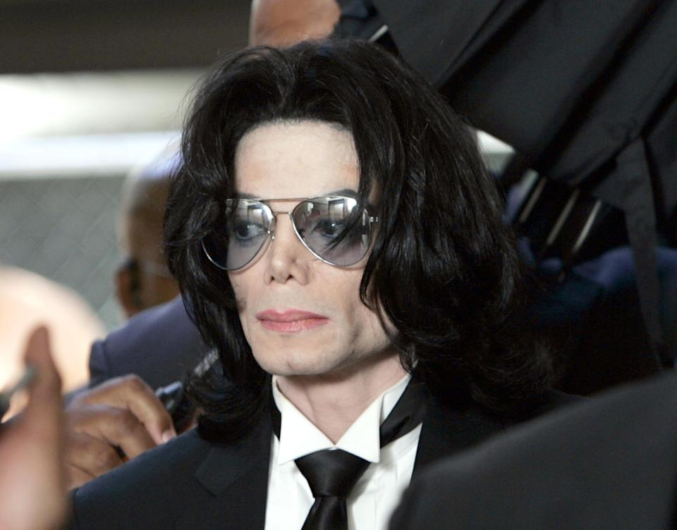 Michael Jackson enters the Santa Barbara County Superior Court to hear the verdict read in his child molestation case on June 13, 2005. (Photo Kevork Djansezian-Pool/Getty Images)