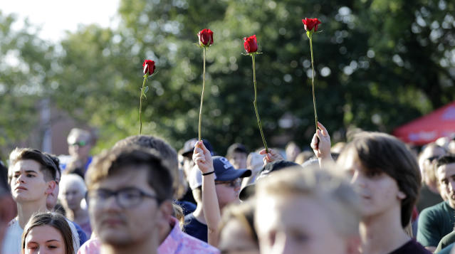<p>Roses are held up during a prayer vigil following a shooting at Santa Fe High School in Santa Fe, Texas, on Friday, May 18, 2018. Dimitrios Pagourtzis, 17, has been charged with capital murder in the Friday morning deadly shooting in Santa Fe, near Houston and Galveston. (Photo: David J. Phillip/AP) </p>
