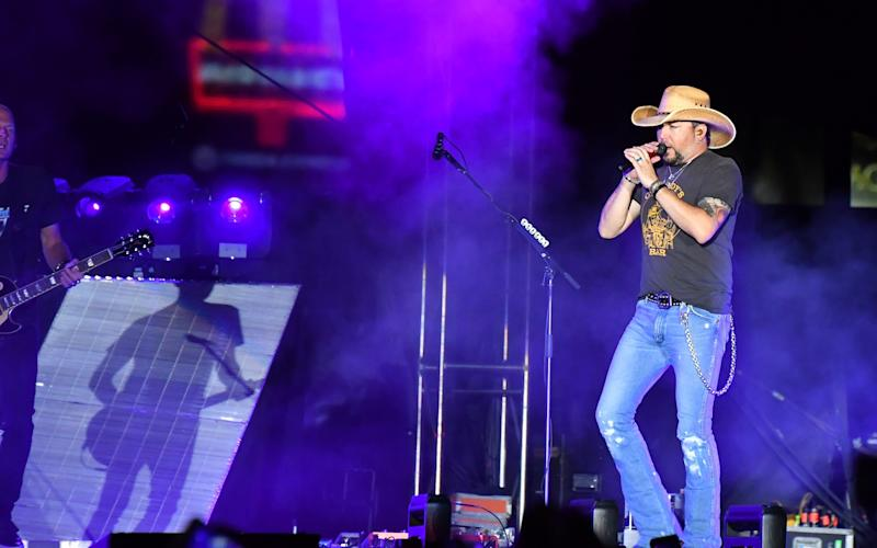 Jason Aldean performing at the Route 91 Harvest country music festival in Las Vegas on Sunday beforethe mass shooting occurred. (Mindy Small via Getty Images)