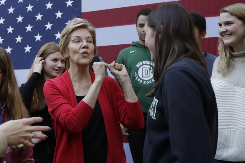 FILE - In this Oct. 24, 2019, file photo, Democratic presidential candidate Sen. Elizabeth Warren, D-Mass., speaks to young people at a campaign event at Dartmouth College in Hanover, N.H. For Warren, it was supposed to be another big idea in a campaign full of them:  A promise that everyone could get government-funded health care, following the lead of her friend and fellow White House hopeful Bernie Sanders. (AP Photo/Elise Amendola)