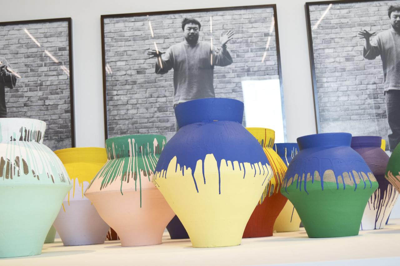 """Chinese artist Ai Weiwei's """"Colored Vases"""" are shown at the Perez Art Museum Miami, Florida in this December 3, 2013 photo. The 16 vases, made during China's Han dynasty and more than 2,000 years old, was dipped in bright paint by the artist. Police on Sunday arrested a man who allegedly smashed a $1 million vase by Chinese dissident artist Ai Weiwei protesting the city's newly opened museum """"only displaying international artists' art.""""  REUTERS/Zachary Fagenson (UNITED STATES - Tags: ENTERTAINMENT CRIME LAW)"""