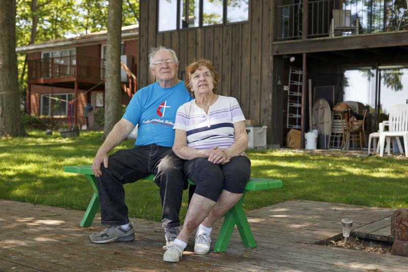 Mike and Judy Gorthy sit in their backyard which reaches to the edge of the nearly empty Sanford Lake on June 2, 2020, in Sanford, Mich. (Elaine Cromie / for NBC News)