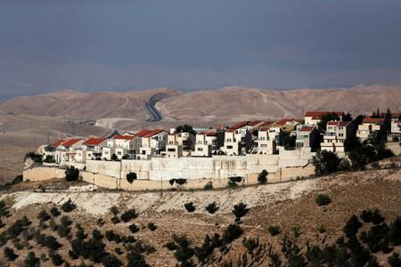 The Wider Image: Israel's settlers and the Palestinians they live among