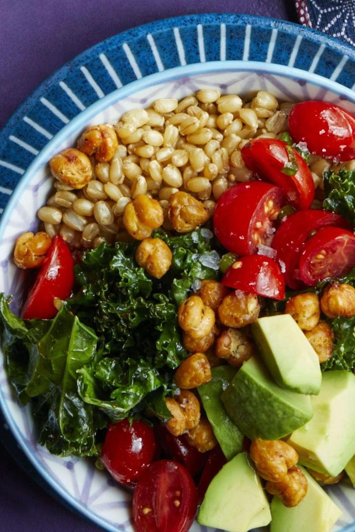 """<p>Think it looks good now? Wait til you drizzle it in Romesco sauce, made with roasted red peppers, parsley and salted almonds.</p><p><em><a href=""""https://www.womansday.com/food-recipes/food-drinks/recipes/a61045/crispy-chickpea-and-kale-bowl-recipe/"""" rel=""""nofollow noopener"""" target=""""_blank"""" data-ylk=""""slk:Get the recipe from Woman's Day »"""" class=""""link rapid-noclick-resp"""">Get the recipe from Woman's Day »</a></em></p>"""