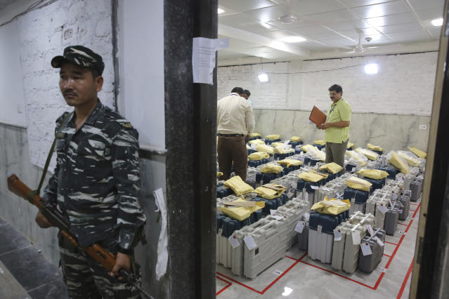 An Indian paramilitary soldier stands guard outside a room where voting machines are stored as counting of votes in India's massive general elections begins in New Delhi, India, Thursday, May 23, 2019. The count is expected to conclude by the evening, with strong trends visible by midday. (AP Photo/Manish Swarup)
