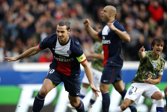 Paris St Germain's Zlatan Ibrahimovic celebrates after scoring a second goal for the team during their French Ligue 1 soccer match against Bastia at the Parc des Princes Stadium in Paris October 19, 2013. REUTERS/Benoit Tessier (FRANCE - Tags: SPORT SOCCER)