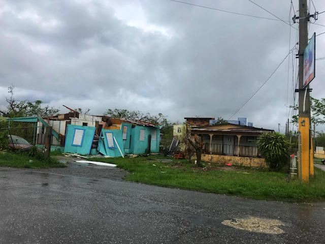 <p>Destroyed homes in the Bayaney barrio of Hatillo, Puerto Rico is without a roof after Hurricane Maria. (Photo: Caitlin Dickson/Yahoo News) </p>