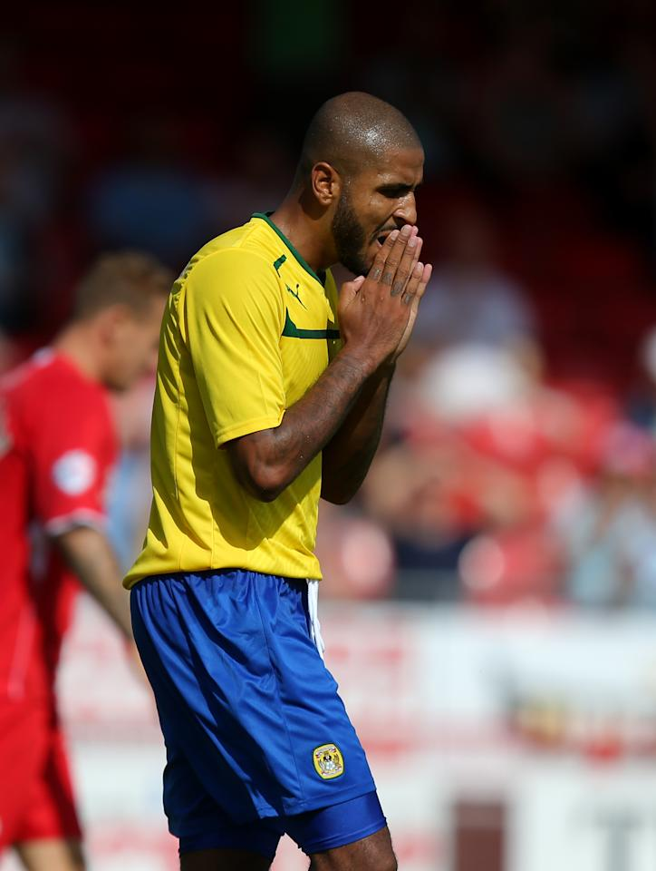 Coventry City's Leon Clarke dejected after a missed opportunity during the Sky Bet League One match at Broadfield Stadium, Crawley.
