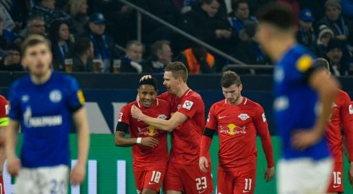 Halstenberg (C) celebrates during Leipzig's 5-0 thrashing of Schalke