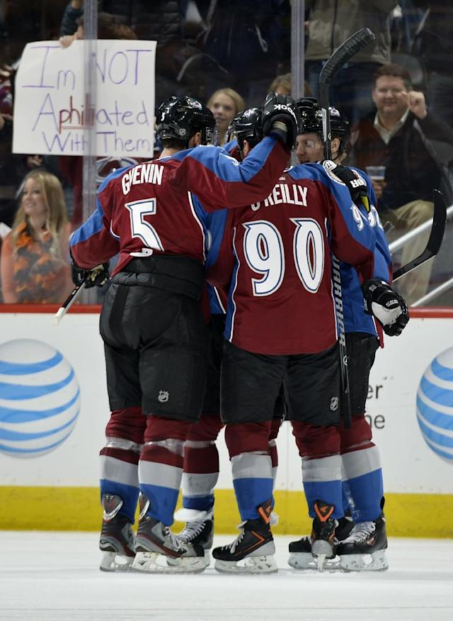 Colorado Avalanche defenseman Nate Guenin (5) and Gabriel Landeskog (92) celebrate a Ryan O'Reilly (90) goal against the Philadelphia Flyers during the second period of an NHL hockey game on Thursday, Jan. 2, 2014, in Denver. (AP Photo/Jack Dempsey)