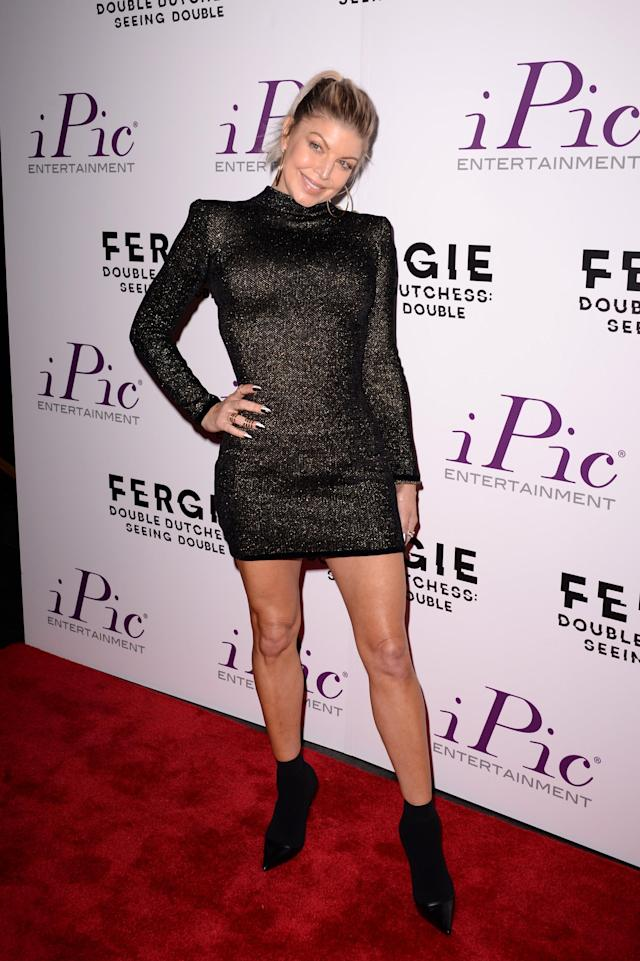 """<p>Following last week's surprising (and sad) announcement that <a href=""""https://www.yahoo.com/entertainment/fergie-josh-duhamel-separate-8-years-marriage-will-always-united-190242185.html"""" data-ylk=""""slk:she and Josh Duhamel had split"""" class=""""link rapid-noclick-resp newsroom-embed-article"""">she and Josh Duhamel had split</a>, the singer <a href=""""https://www.yahoo.com/lifestyle/bizarre-narrative-celebrity-stepping-story-001403568.html"""" data-ylk=""""slk:kept calm and carried on"""" class=""""link rapid-noclick-resp newsroom-embed-article"""">kept calm and carried on</a> at the New York City premiere of her new visual album, <em>Double Dutchess: Seeing Double. </em>(Photo: Andrew Toth/Getty Images) </p>"""