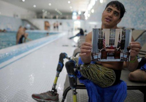 Afghan amputee Malek Mohammad during an interview after training at a Kabul wimming pool. Malek is one of tens of thousands of Afghan amputees, victims of three decades of war that have made Afghanistan one of the most heavily mined countries in the world