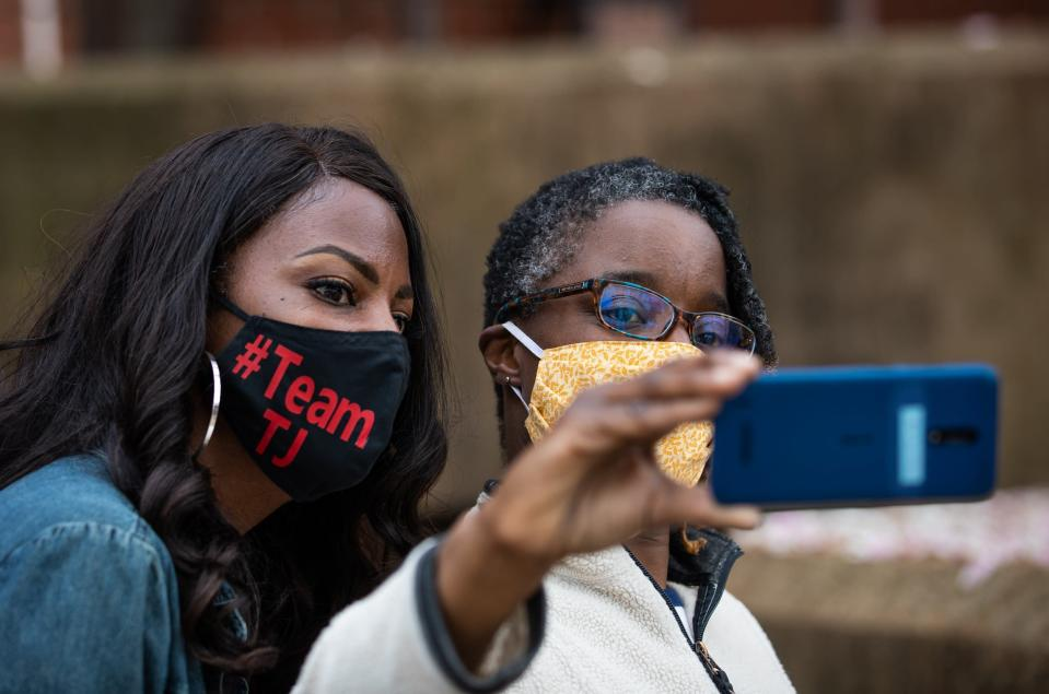 Mayoral Candidate Tishaura Jones, left, takes a selfie with Aldermanic Candidate for the 17th Ward, Tina Pihl, outside the polling place at the corner of Newstead and Laclede Avenues in the Central West End in St. Louis on Tuesday, April 6, 2021. (Sara Diggins/St. Louis Post-Dispatch via AP)