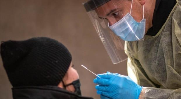 A COVID-19 test is administered at Dalhousie University in November. Nova Scotia reported 32 new cases of COVID-19 on Tuesday. (Robert Short/CBC - image credit)