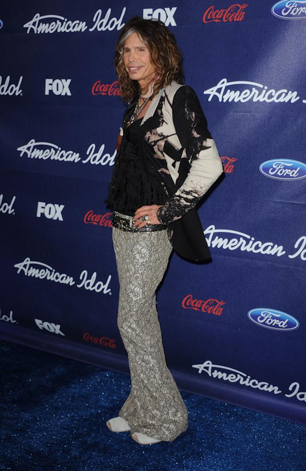 "Steven Tyler attends the Season 11 ""<a href=""http://tv.yahoo.com/american-idol/show/34934"">American Idol</a>"" Top 13 Finalists Party on Thursday, March 1 at The Grove in Los Angeles, CA."