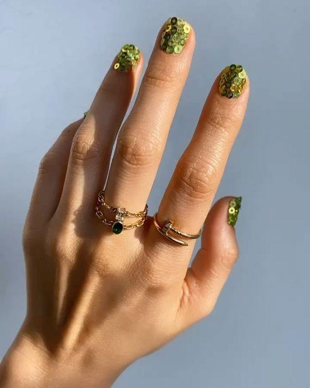 """<p>Not only is this Saint Patrick's Day <a href=""""https://www.cosmopolitan.com/style-beauty/beauty/g30858051/short-nail-design-ideas/"""" target=""""_blank"""">nail idea</a> super fun, but you'll def also catch the attention of your crush across the bar with a mani this sparkly.</p><p><strong>Recreate it with:</strong> <a href=""""https://www.amazon.com/Holographic-Iridescent-Confetti-Supplies-Decoration/dp/B0834WN18K/ref=sr_1_6?"""" target=""""_blank"""">Nail Sequins</a></p><p><a href=""""https://www.instagram.com/p/B8xGK33gzm0/"""">See the original post on Instagram</a></p>"""