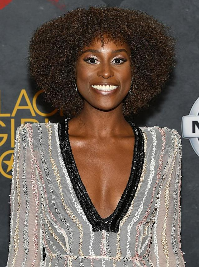 <p>Black Girls Rock! 2017 honoree Issa Rae is further proof that curly hair and bangs can go together quite well. Natural-hair expert Felicia Leatherwood framed Rae's tight coils perfectly, and celeb makeup artist Joanna Simkin played up the star's almond eyes with metallic eyeshadow. (Photo: Dia Dipasupil/Getty Images for BET) </p>
