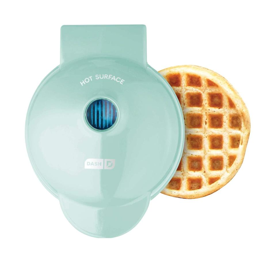"""<h3>Dash Mini Waffle Maker</h3><br>This palm-sized waffle iron is tiny in size, but creates off-the-charts-level of delicious breakfasts.<br><br><strong>Rating:</strong> 4.7 out of 5 stars, and 148,383 reviews<br><br><strong>A Satisfied Customer Review: </strong>""""YES! Tiny Eggo-sized waffles! Put anything into it- hashbrowns, tater tots, waffle mix, canned biscuits! Add nuts and berries and things! It even comes with a little recipe booklet! It fits in the palm of your hand, you could literally stuff it in the back of a drawer, but you won't, because as soon as you get it everyone wants mini waffles for every meal. It heats up super fast and is a breeze to clean. If you're making a whole mess of waffles, be sure to give it a quick spritz of nonstick spray every couple waffles or so, so it doesn't rend your delicious waffles asunder. Excellent value. Buy 10 of them and a food truck, you'll be in business.""""<br><br><strong>Dash</strong> Mini Waffle Maker Machine, 4 Inch, $, available at <a href=""""https://amzn.to/3eIJu3G"""" rel=""""nofollow noopener"""" target=""""_blank"""" data-ylk=""""slk:Amazon"""" class=""""link rapid-noclick-resp"""">Amazon</a>"""