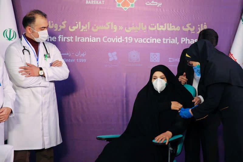 A nurse prepares to inject a volunteer taking part in an Iranian coronavirus disease (COVID-19) vaccine trial in Tehran