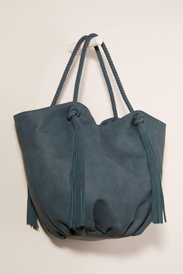 """<p>This <a href=""""https://www.popsugar.com/buy/Morgan-Tasseled-Tote-Bag-537120?p_name=Morgan%20Tasseled%20Tote%20Bag&retailer=anthropologie.com&pid=537120&price=88&evar1=fab%3Aus&evar9=45623846&evar98=https%3A%2F%2Fwww.popsugar.com%2Ffashion%2Fphoto-gallery%2F45623846%2Fimage%2F47066459%2FMorgan-Tasseled-Tote-Bag&list1=shopping%2Caccessories%2Cbags%2Cworkwear&prop13=mobile&pdata=1"""" rel=""""nofollow"""" data-shoppable-link=""""1"""" target=""""_blank"""" class=""""ga-track"""" data-ga-category=""""Related"""" data-ga-label=""""https://www.anthropologie.com/shop/morgan-tasseled-tote-bag3?category=bags-totes&amp;color=044&amp;quantity=1&amp;size=One%20Size&amp;type=STANDARD"""" data-ga-action=""""In-Line Links"""">Morgan Tasseled Tote Bag</a> ($88) comes in a ton of fun color choices.</p>"""