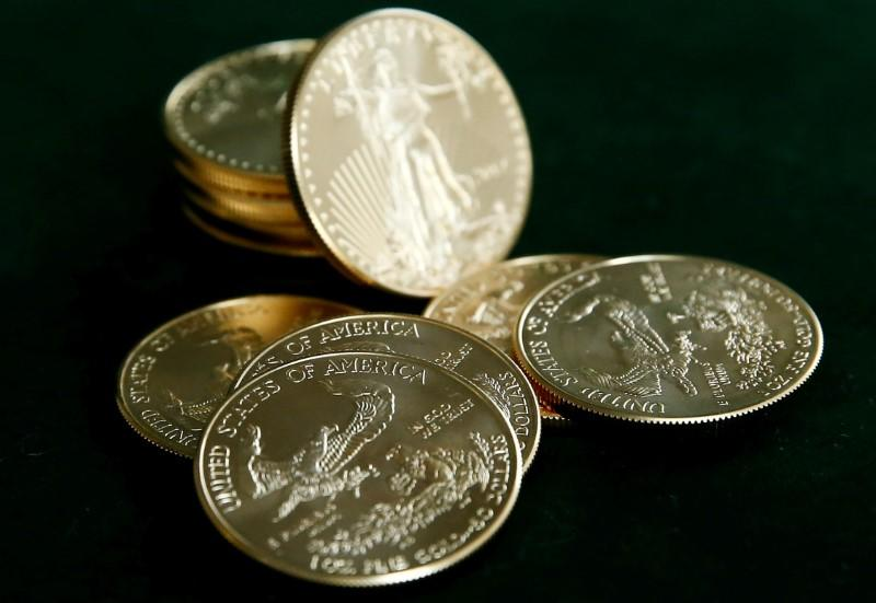 Gold U.S. dollar bullion coins are seen in this photo illustration taken in Moscow