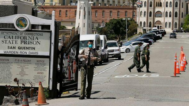 PHOTO: In this July 9, 2020, file photo, a correctional officer stands at the main gate of San Quentin State Prison in San Quentin, Calif. (Eric Risberg/AP, FILE)