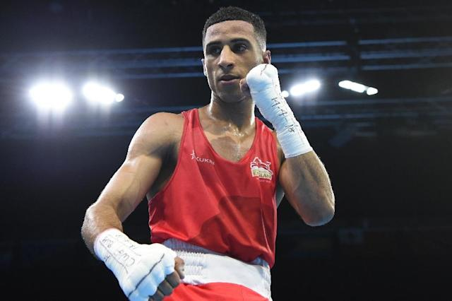 England's Galal Yafai celebrates beating India's Amit in their men's 46-49kg final and taking gold at the 2018 Commonwealth Games (AFP Photo/Anthony WALLACE )