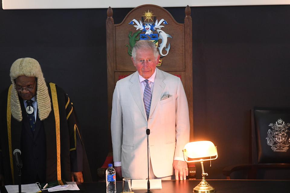 HONIARA, GUADALCANAL ISLAND, SOLOMON ISLANDS - NOVEMBER 25:  Speaker of the National Parliament of Solomon Islands John Patteson Oti (L) listens as Prince Charles, Prince of Wales address the National Parliament of the Solomon Islands at Parliament House during day three of the royal visit to the Solomon Islands on November 25, 2019 in Honiara, Guadalcanal Island, Solomon Islands. The Prince of Wales and Duchess of Cornwall just finished a tour of New Zealand. It was their third joint visit to New Zealand and first in four years. The Prince is currently on a solo three day tour of The Solomon Islands. (Photo by  Victoria Jones - Pool/Getty Images)