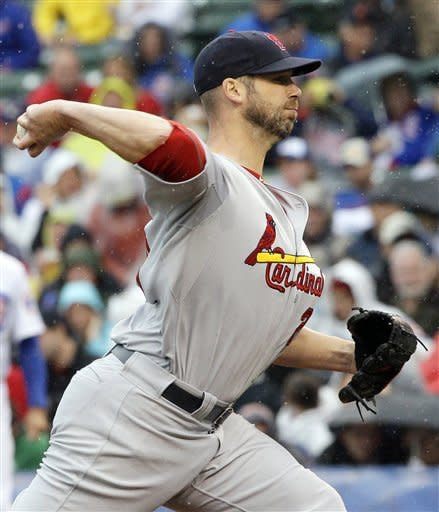 As rain falls, St. Louis Cardinals starter Chris Carpenter throws against the Chicago Cubs during the first inning of a baseball game in Chicago, Friday, Sept. 21, 2012. (AP Photo/Nam Y. Huh)