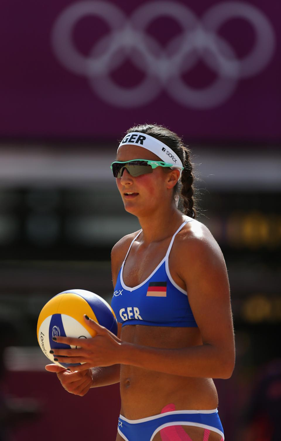 LONDON, ENGLAND - JULY 28: Ilka Semmler of Germany serves during the Women's Beach Volleyball match between Germany and Czech Republic on Day 1 of the London 2012 Olympic Games at Horse Guards Parade on July 28, 2012 in London, England. (Photo by Alexander Hassenstein/Getty Images)