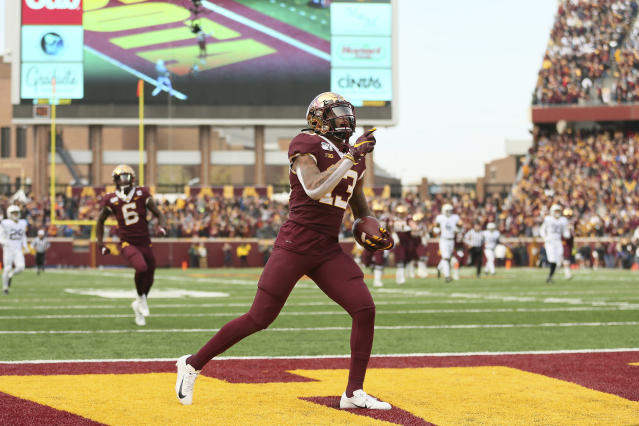 Minnesota wide receiver Rashod Bateman (13) runs the ball in the end zone for a touchdown during an NCAA college football game against Penn State, Saturday, Nov. 9, 2019, in Minneapolis. (AP Photo/Stacy Bengs)