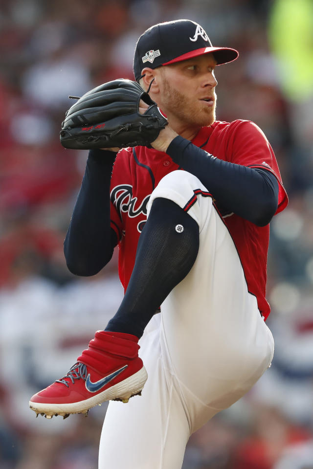 Atlanta Braves starting pitcher Mike Foltynewicz (26) works in the fifth inning during Game 2 of a best-of-five National League Division Series, Friday, Oct. 4, 2019, in Atlanta. (AP Photo/John Bazemore)
