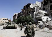 Syrian forces are planning to recapture lost territory in Hama and Idlib provinces (AFP Photo/Louai Beshara)