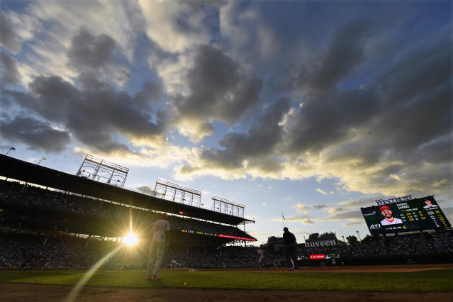 The suns sets behind Great American Ball Park during the second inning of a baseball game between the Chicago Cubs and the Cincinnati Reds, Monday, July 15, 2019, in Chicago. (AP Photo/Paul Beaty)