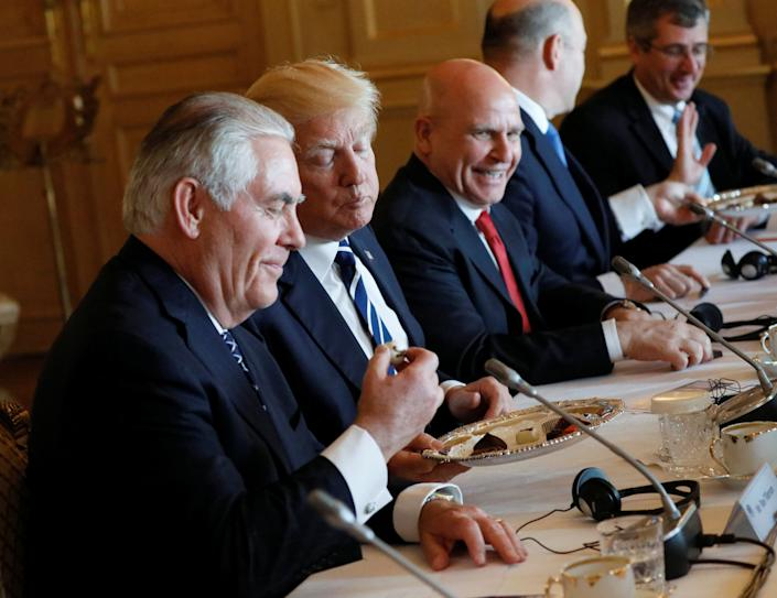 U.S. Secretary of State Rex Tillerson, Trump and national security adviser H.R. McMaster eat Belgian chocolate during their meeting with Belgian Prime Minister Charles Michel in Brussels, Belgium.