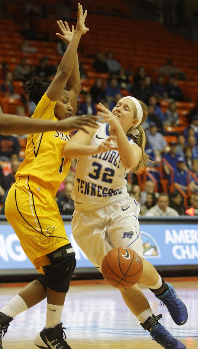 Middle Tennessee's Caroline Warden, right, is stripped of the ball as she drives against Southern Miss' Jamierra Faulkner in an NCAA college basketball game during the first half of their Conference USA Tournament championship Saturday, March 15, 2014 in El Paso, Texas. (AP Photo/Victor Calzada)