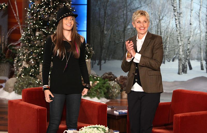 """In this Dec. 13, 2011 photo released by Warner Bros., talk show host Ellen DeGeneres, right, welcomes Paris Jackson, daughter of the late pop star Michael Jackson during a taping of """"The Ellen DeGeneres Show"""" in Burbank, Calif.  The episode will air on Thursday. (AP Photo/Warner Bros., Michael Rozman)"""