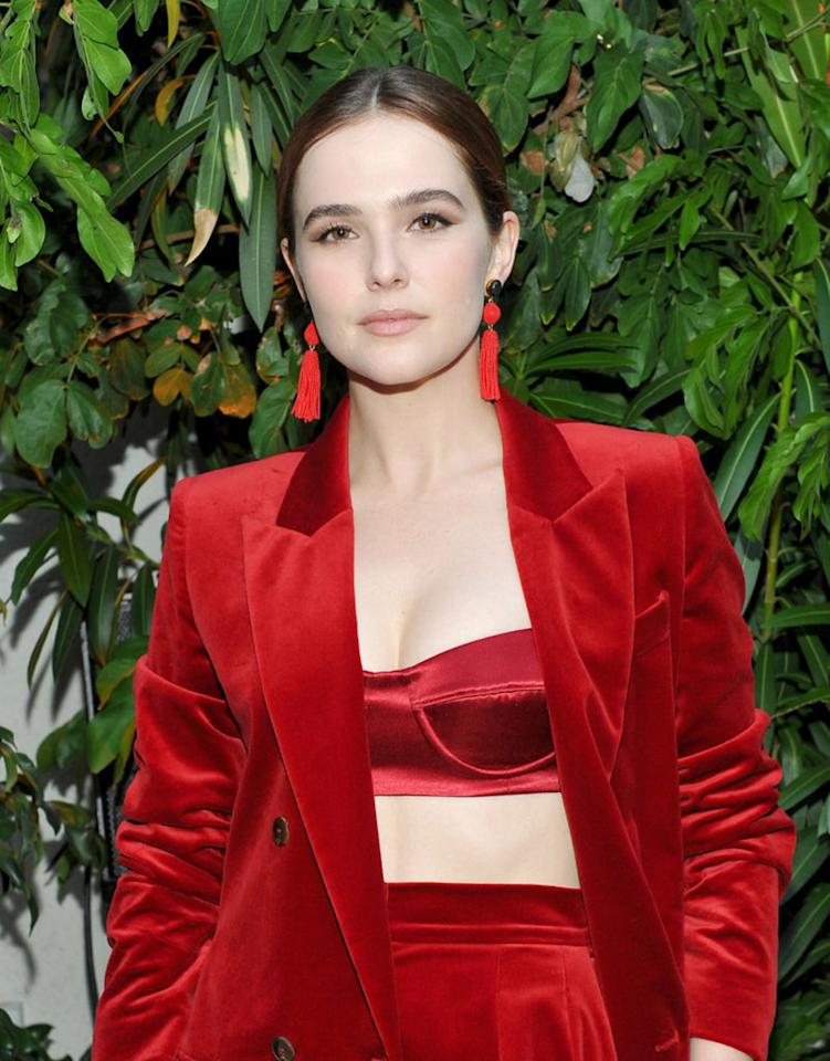 <p>Honoree Zoey Deutch looked ravishing in a red Max Mara pantsuit at the the 2017 Women in Film Max Mara Face of the Future event in Los Angeles. With her brunette hair pulled off of her face, we get to see the actress's winged eyeliner and stunning tassel earrings. (Photo: Donato Sardella/Getty Images for Max Mara) </p>