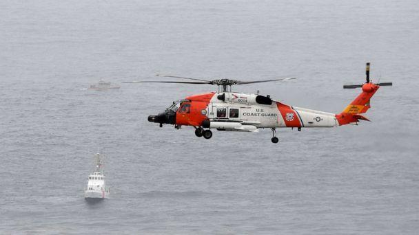 PHOTO: A U.S. Coast Guard helicopter flies over boats searching the area where a boat capsized just off the San Diego coast, May 2, 2021, in San Diego. (Denis Poroy/AP)