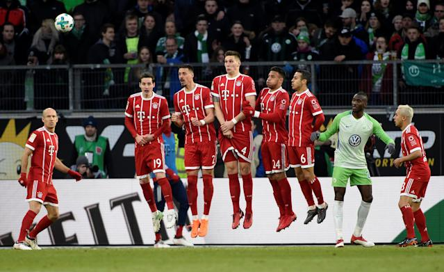 Soccer Football - Bundesliga - VfL Wolfsburg vs Bayern Munich - Volkswagen Arena, Wolfsburg, Germany - February 17, 2018 Bayern Munich's Niklas Sule, Sandro Wagner and team mates jump to defend a free kick REUTERS/Fabian Bimmer DFL RULES TO LIMIT THE ONLINE USAGE DURING MATCH TIME TO 15 PICTURES PER GAME. IMAGE SEQUENCES TO SIMULATE VIDEO IS NOT ALLOWED AT ANY TIME. FOR FURTHER QUERIES PLEASE CONTACT DFL DIRECTLY AT + 49 69 650050