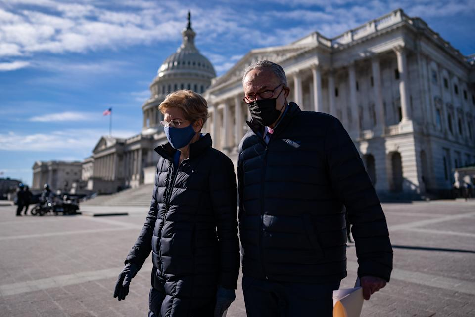 WASHINGTON, DC - FEBRUARY 4: Sen. Elizabeth Warren (D-Mass.,) and Senate Majority Leader Sen. Chuck Schumer (N.Y.,) arrive for a news conference on Capitol Hill in Washington, D.C., Thursday, February 4, 2021. The press conference called on President Biden to take action to cancel up to $50,000 in debt for federal student loans by executive action. (Photo by Salwan Georges/The Washington Post via Getty Images)