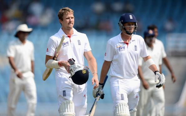 MUMBAI, INDIA - NOVEMBER 05:  Nick Compton and Joe Root of England leave the field for lunch during day three of the tour match between Mumbai A and England at The Dr D.Y. Palit Sports Stadium on November 5, 2012 in Mumbai, India.  (Photo by Gareth Copley/Getty Images)