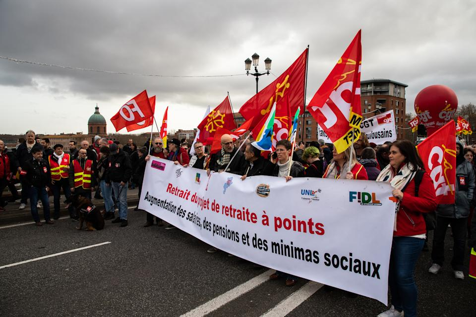 Thousands of demonstrators on 17 December 2019 took to the streets of Toulouse, languedoc -Roussillon-Midi-Pyrenees, France,  against the government's plans for pension about 120 000 by the count of the union CGT against 17000 by the count of the government. All the union were here to rally, with yellow vest ,teachers, students,rail workers, public services, firement, hospital, education. (Photo by Jerome Gilles/NurPhoto via Getty Images)