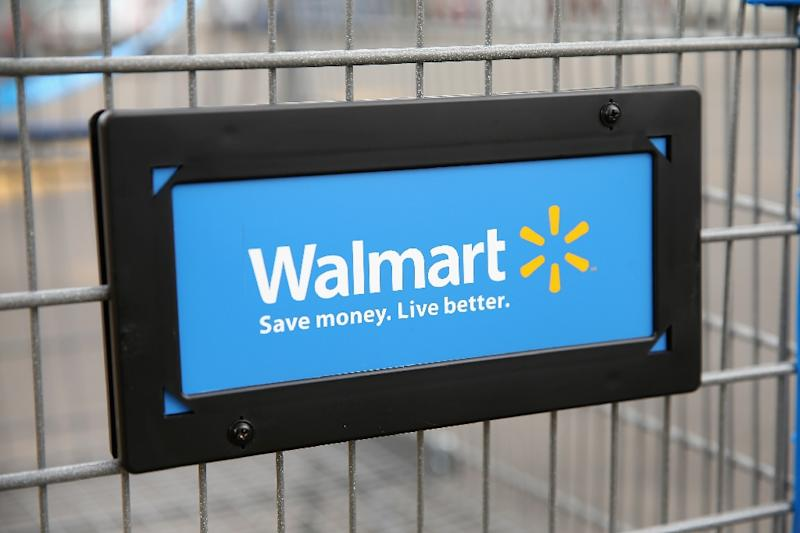 Wal-Mart's US stores turned in another quarter of increased sales on the retailing giant reported a drop in profits due to higher expenses as it strives to compete with online behmoth Amazon