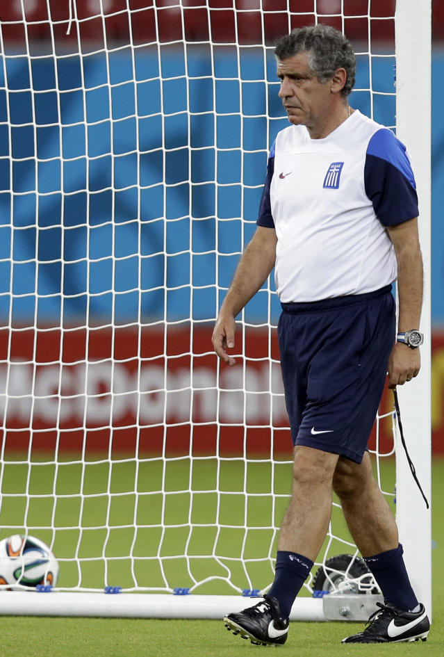 Greece's head coach Fernando Santos walks on the pitch during a training session of Greece in the Arena Pernambuco stadium, Recife, Brazil, Saturday, June 28, 2014. Greece will play Costa Rica in a World Cup round of 16 soccer match next June 29.(AP Photo/Andrew Medichini)
